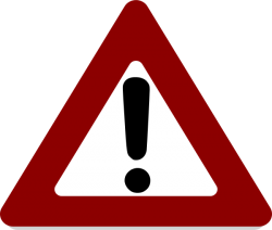 Icon of large triangle with exclamation point inside